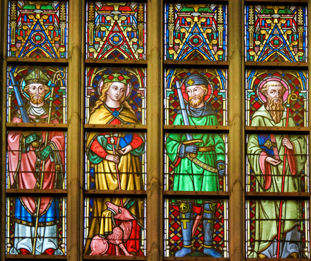 Stained Glass window depicting Saints Thomas, Margaret, Hermes and Hildebert in the Cathedral of Saint Bavo in Ghent, Flanders, Belgium.