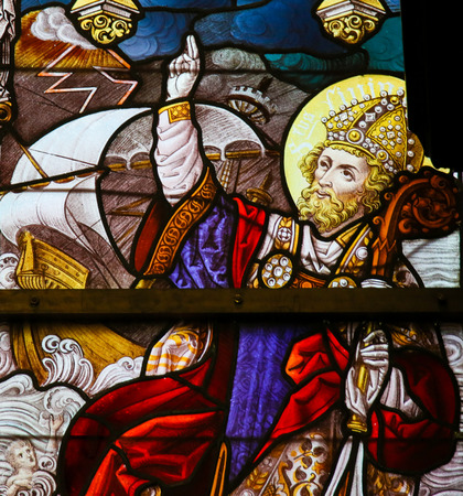 gent: Stained Glass depicting Saint Livinus and a ship in heavy weather, in the Cathedral of Saint Bavo in Ghent, Belgium. Editorial