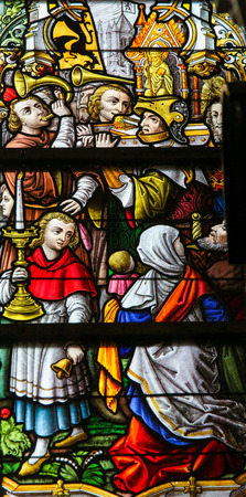 Stained Glass window depicting a Procession in the Cathedral of Saint Bavo in Ghent, Flanders, Belgium.