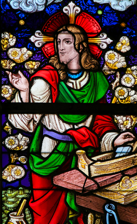 gent: Stained Glass window depicting Jesus Christ at work as a carpenter in the Cathedral of Saint Bavo in Ghent, Flanders, Belgium. Editorial
