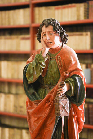 new testament: Statue of St John the Evangelist in the Library of Strahov Monastery, Prague, Czech Republic