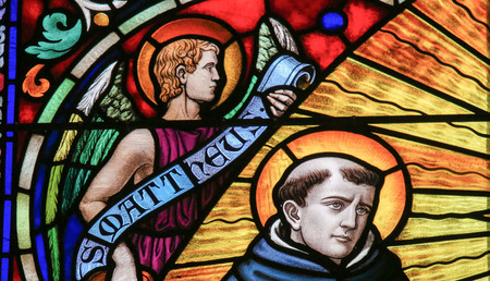 MECHELEN, BELGIUM - NOVEMBER 4, 2016: Stained Glass depicting Saint Thomas Aquinas (1225 - 1274), Italian Dominican friar, Catholic priest, and Doctor of the Church, in Mechelen Cathedral, Belgium.