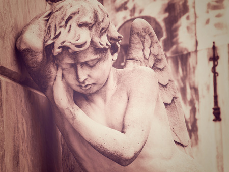 angel cemetery: Mourning Angel Statue in Recoleta Cemetery, Buenos Aires, Argentina. Stock Photo