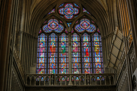 BAYEUX, FRANCE - FEBRUARY 12, 2013: Stained Glass window in the Cathedral of Bayeux, France, depicting Catholic Saints