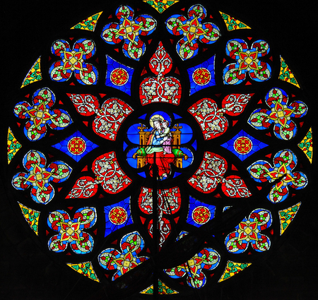 Stained Glass Rose Window or Rosette in the Church of Our Blessed Lady of the Sablon in Brussels, Belgium.