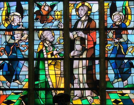 handing over: Stained Glass in the Church of Tervuren, Belgium, depicting Jesus Christ handing over the Keys to Heaven to Saint Peter