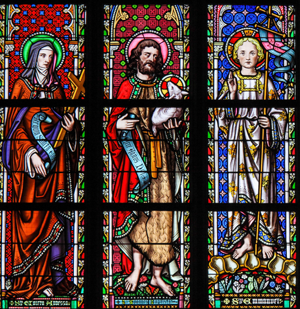 Stained Glass in the Church of Our Blessed Lady of the Sablon in Brussels, Belgium, depicting Saints Colette, John the Baptist and Emmanuel