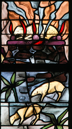 Stained Glass in the Church of Tervuren, Belgium, depicting a burning lamb, symbolizing the Agnus Dei