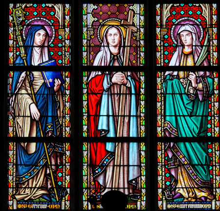 of our lady: Stained Glass in the Church of Our Blessed Lady of the Sablon in Brussels, Belgium, depicting Catholic Saints