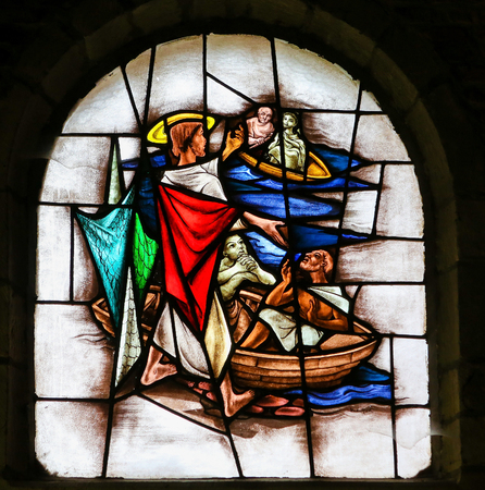 Stained Glass window in the 15th Century Elzenveld Chapel in Antwerp, Belgium, depicting Jesus Calling Four Fishermen to Follow Him