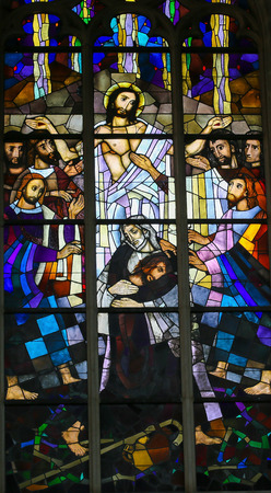 Stained Glass window in the Church of Saint Andrew in Antwerp, Belgium, depicting Jesus and the Parable of the Prodigal Son