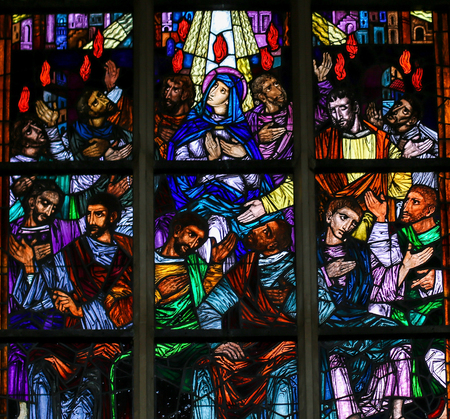 Stained Glass window in the Church of Saint Andrew in Antwerp, Belgium, depicting Mary and the Apostles at Pentecost