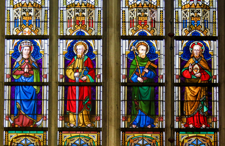 Stained Glass window depicting Catholic Saints in the Cathedral of Saint Bavo in Ghent, Flanders, Belgium, including Jesus, Saint Paul and Saint Joseph