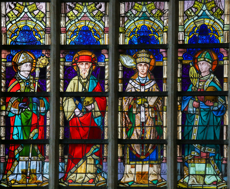 Stained Glass window in St Gummarus Church in Lier, Belgium, depicting Catholic Saints Augustine, Jerome, Gregory and Ambrose