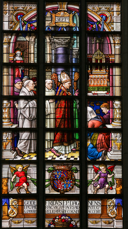 mitre: Stained Glass window in St Gummarus Church in Lier, Belgium, depicting a Bishop and Priests