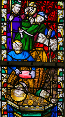 savagery: Stained Glass window depicting the Martyrdom of a Catholic Saint in the Cathedral of Saint Bavo in Ghent, Flanders, Belgium.