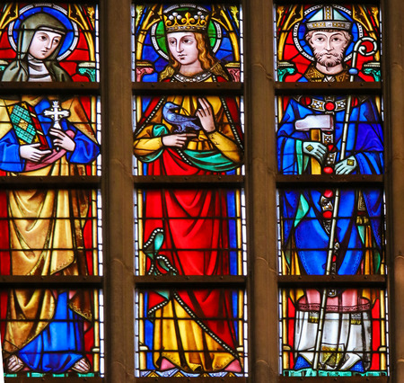 Stained Glass window depicting Catholic Saints including Saint Eligius or Eloy in the Cathedral of Saint Bavo in Ghent, Flanders, Belgium. Editorial