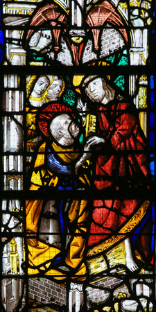 Jesus and Saint Peter on a stained glass in the cathedral of Rouen, France