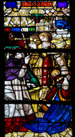 Temperance: St Romain is tempted by women on a stained glass (1520) in the cathedral of Rouen, France