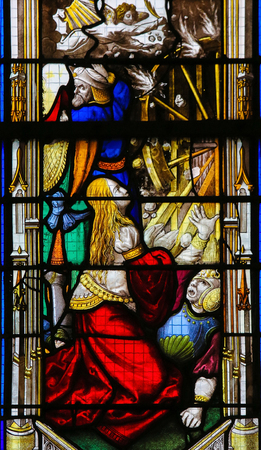 Saint Catherine on a stained glass in the cathedral of Rouen, France Editorial