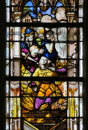 Martyrdom of a Catholic Saint on a stained glass in the cathedral of Rouen, France