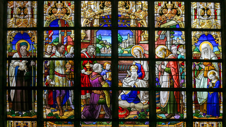 Stained Glass window in St Gummarus Church in Lier, Belgium, depicting an Epiphany Scene, with the Visit of the Three Magi to Bethlehem