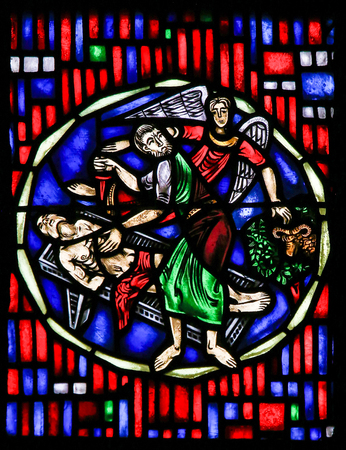 Stained Glass in Wormser Dom in Worms, Germany, depicting the Sacrifice of Isaac by Abraham