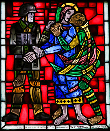 holy thursday: Stained Glass in Wormser Dom in Worms, Germany, depicting the traitor Judas kissing Jesus on the Mount of Olives Editorial