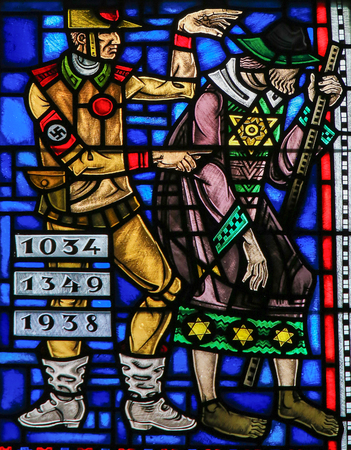 Stained Glass in Wormser Dom in Worms, Germany, depicting the Holocaust againts Jews by the Nazis