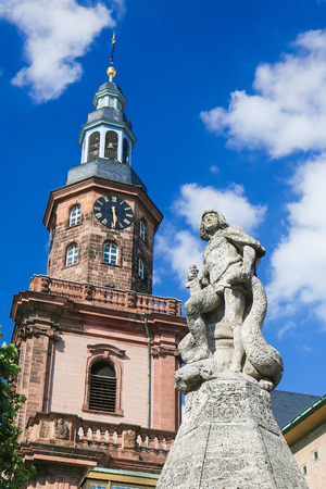 Statue of Siegfried and the Holy Trinity Church, the largest Protestant church in Worms, Germany.