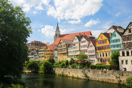 View on houses and the Stiftskirche in the historical center of Tubingen, by the River Neckar in Baden Wurttemberg, Germany.