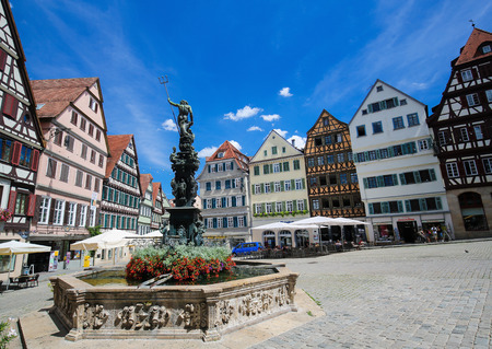 Neptune Fountain and half-timbered houses in the historical center of Tubingen, Baden Wurttemberg, Germany.