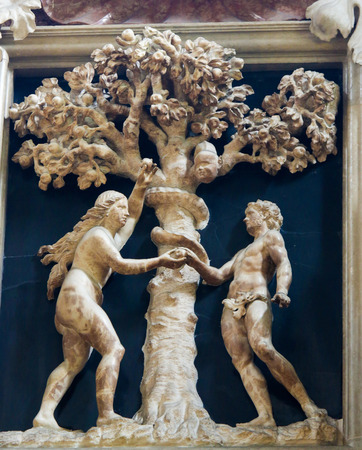 Sculpture of Adam and Eve and the Forbidden Fruit at the Cathedral of San Vigilio in Trento, Italy