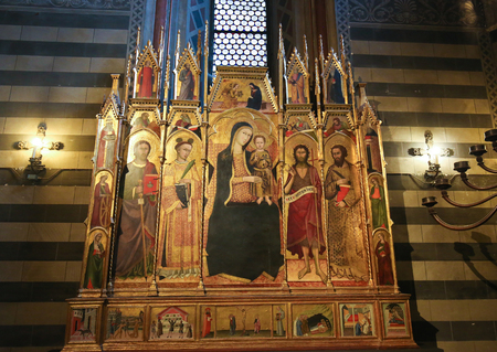 14th Century Polyptich by Andrea Vanni in the Siena Baptistery of San Giovanni at the Cathedral of Siena, depicting Mother Mary, Saints James the Greater, Bartholomew, John the Baptist  and Stephen