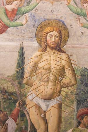 Fresco depicting The Martyrdom of St Sebastian by Benozzo Gozzoli (1465) in the Collegiata of San Gimignano, Italy.