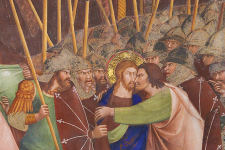 Judas betrays Jesus with a kiss. 14th Century Fresco in the Collegiata of San Gimignano, Italy. Editorial