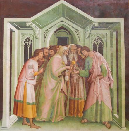 Judas receives thirty pieces of silver to betray Jesus. Fresco in the Collegiata of San Gimignano, Italy.