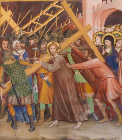 Renaissance Fresco depicting Jesus carrying the cross on the Via Dolorosa in the Collegiata of San Gimignano, Italy.