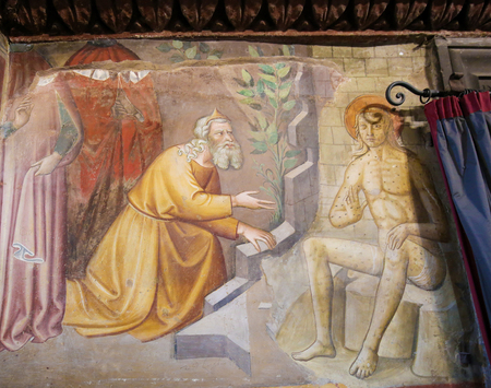 Renaissance Fresco depicting Job, plagued by boils, visited by his friends, in the Collegiata of San Gimignano, Italy. Editorial