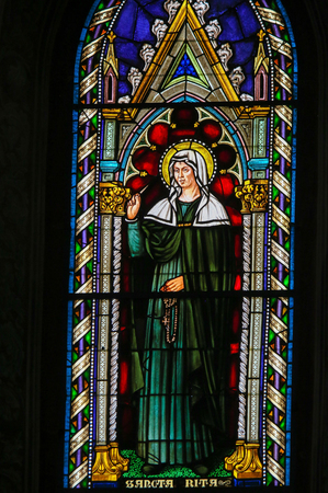 Stained Glass in the Church of Sant Agostino (St Augustine), one of the oldest churches of San Gimignano, Tuscany, Italy, depicting Saint Rita