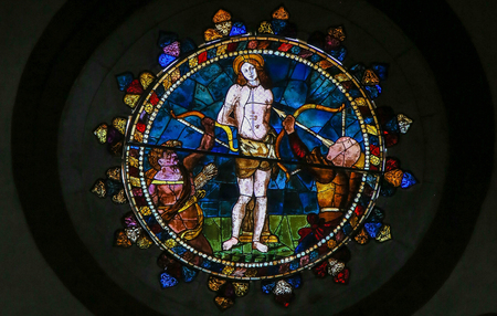 Stained Glass in the Basilica of San Petronio, Bologna, Emilia Romagna, Italy, depicting the Martyrdom of Saint Sebastian Editorial