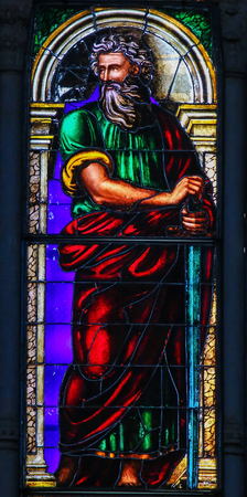 Stained Glass in the Basilica of San Petronio, Bologna, Emilia Romagna, Italy, depicting the Apostle Saint Paul or Paulus, holding the sword. Editorial