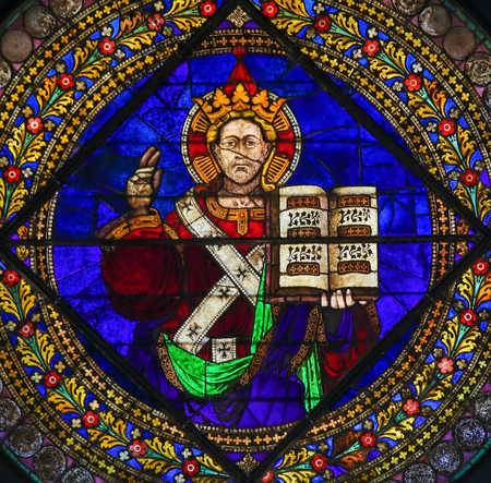 new testament: Stained Glass in the Basilica of San Petronio, Bologna, Emilia Romagna, Italy, depicting Jesus holding the Holy Scripture Editorial