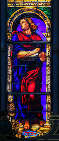Stained Glass in the Basilica of San Petronio, Bologna, Emilia Romagna, Italy, depicting Saint John the Evangelist