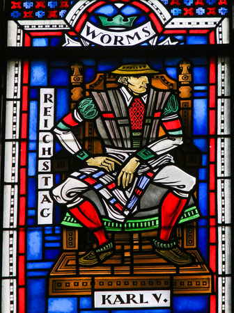 Stained Glass in Wormser Dom in Worms, Germany, depicting Emperor Charles V, president of the Diet of Worms in 1521 in which Martin Luther was declared a heretic