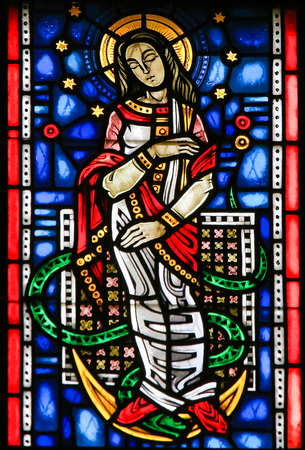Stained Glass in Wormser Dom in Worms, Germany, depicting the Virgin Mary stepping on a snake