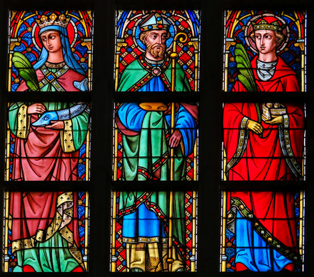 Stained Glass window in the Cathedral of Saint Bavo in Ghent, Flanders, Belgium, depicting Catholic Saints Editorial