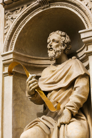 Statue at the Santa Casa of Loreta, a large pilgrimage site in Hradcany, Prague, of a figure holding a Sacred Text Stock Photo