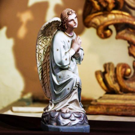 Statue of a Praying Angel in Loreta church, Prague