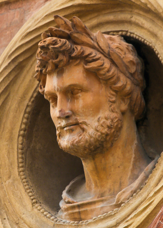 Bust of a Roman Emperor with a laurel crown at the Palazzo Bolognini Amorini Salina, a Renaissance architecture palace located on Piazza Santo Stefano in Bologna, Italy. Editorial